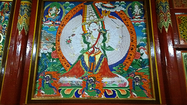 A wall painting inside the Grand Sutra Hall - Labrang Monastery and Xiahe, Gansu