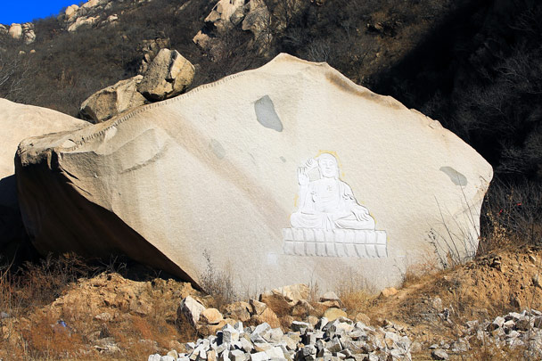 A Buddha carved into a boulder. Over the years we've seen this boulder get smaller as blocks were chipped away. We hope they leave it with the buddha - Zhuangdaokou to Moss Mountain, 2017/2/11