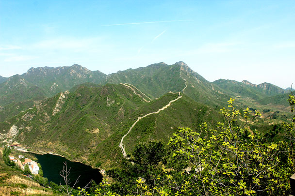 The wall dips down to the reservoir, and then disappears into the mountains on the other side - Walled Village to Huanghuacheng Great Wall, 2017/4/22