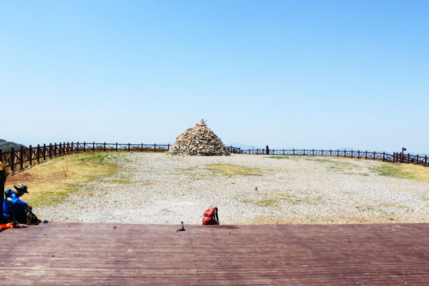 A platform and a pile of rocks mark the high point -