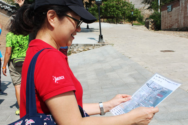 Studying the map to find the hidden treasure - Teambuilding for Merck with Great Wall hike and treasure hunt, 2017/7/7
