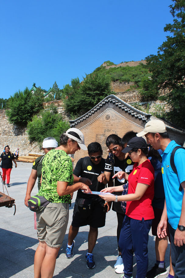Discussing where to go next - Teambuilding for Merck with Great Wall hike and treasure hunt, 2017/7/7