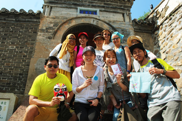 Team Blue showing off their treasures: Peking Opera mask, silk embroidery, paper cutting, ancient style cup - Teambuilding for Merck with Great Wall hike and treasure hunt, 2017/7/7