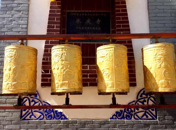 Prayer wheels around the main building of the monastery - Alashan Desert Lakes and Temple, Inner Mongolia, 2017/10