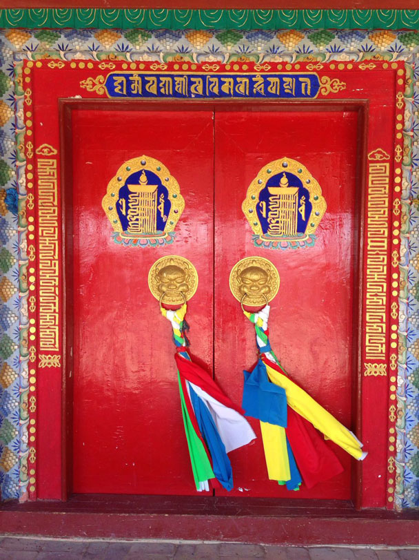 Red doors and prayer flags - Alashan Desert Lakes and Temple, Inner Mongolia, 2017/10