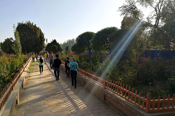 Walking through a park towards the mosque - Along the Silk Road from Korla to Kashgar, October 2017