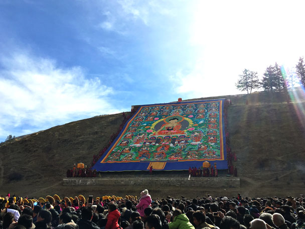 Unveiled on the hill, accompanied by pomp and ceremony. This year they unveiled the Shakayamuni thangka - Unveiling the Buddha at Labrang Monastery, 2018/02