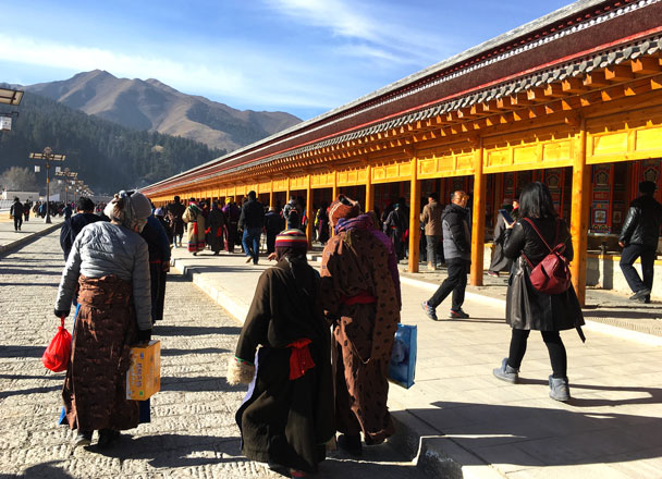 Pilgrims in ceremonial clothing - Unveiling the Buddha at Labrang Monastery, 2018/02