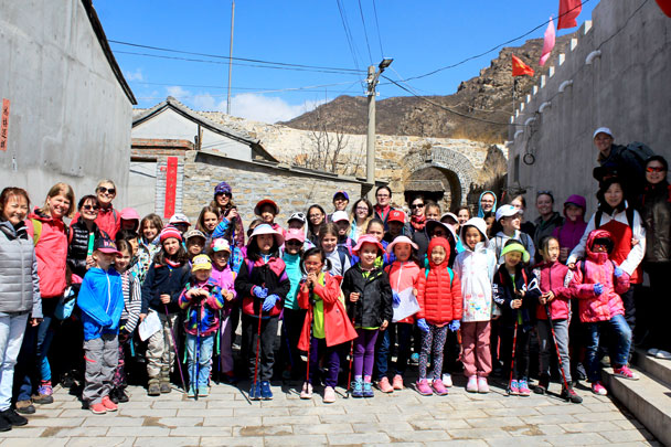 Group photo in front of an arch in the old village walls - Girl Scouts hike at Changyucheng, 2018/04/14