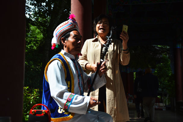 Singing opera in the park - Lijiang and Shangri-La, Yunnan Province, July 2018