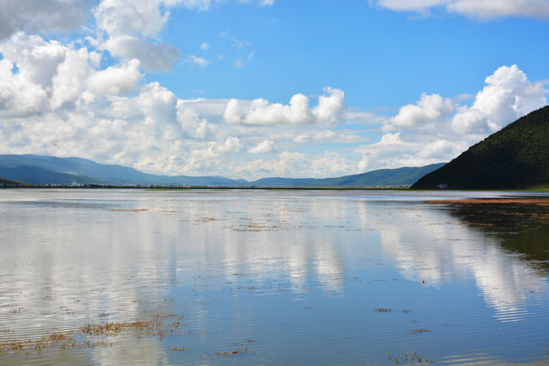 Beautiful Napa Lake with reflections of blue sky and white cloud in Shangri-La - Lijiang and Shangri-La, Yunnan Province, July 2018