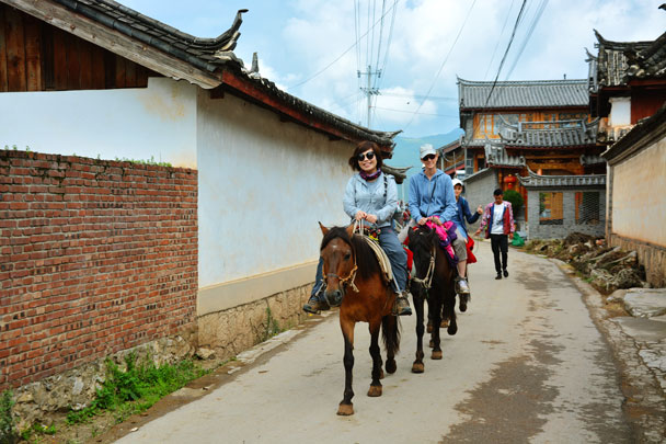 Horse-riding through a Naxi village along the Ancient Horse and Tea Road - Lijiang and Shangri-La, Yunnan Province, July 2018