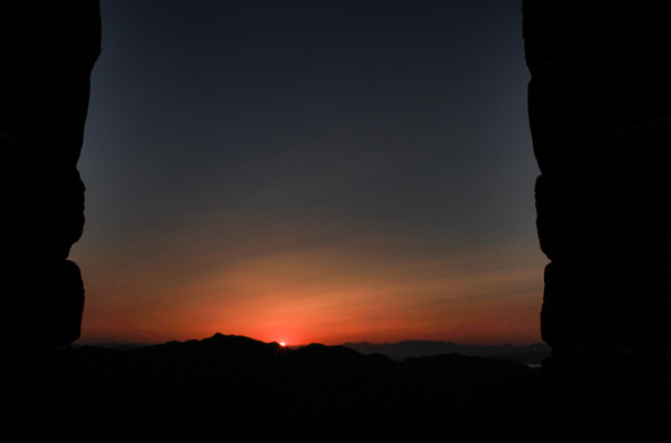 Sunset, seen through the window of a tower - Switchback Great Wall Camping, 2016/03/26