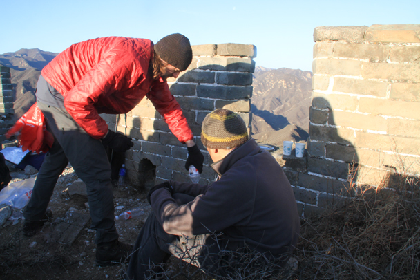 Jake is heating up water for coffee and tea - Switchback Great Wall Camping, 2016/03/26