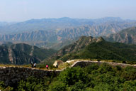A stretch of unrestored Great Wall, with mountains in the background