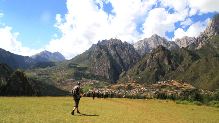 Hiking through high-altitude meadows in the mountains near Zhagana