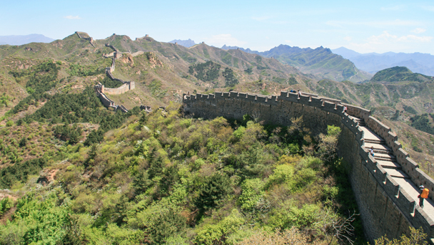 Hikers on the Great Wall, approaching the restored Jinshanling section