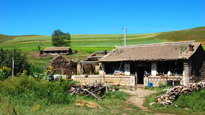 A farmhouse in the grasslands