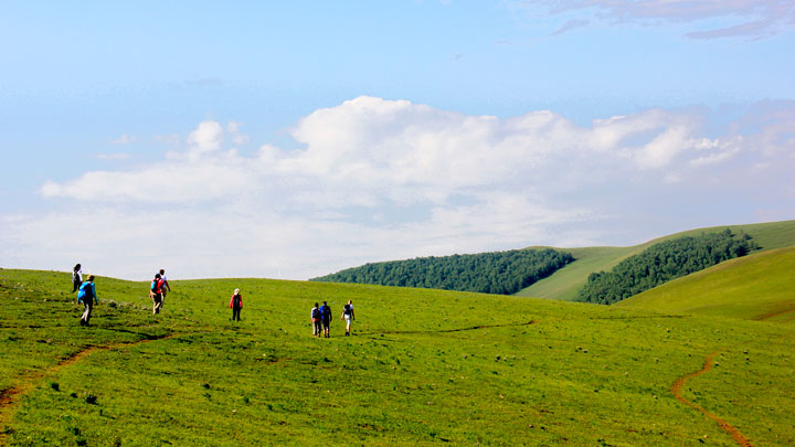 Hiking through the rolling hills of the Bashang Grasslands