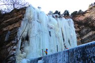 Climbers on a frozen waterfall at Immortal Valley