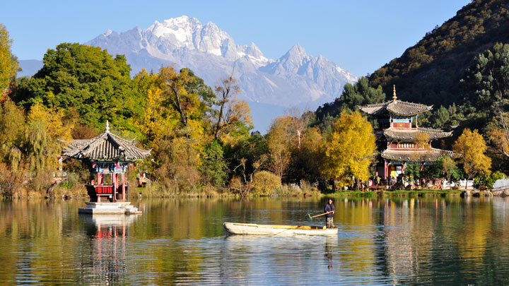 Lijiang's Black Dragon Pool, with the Jade Dragon Snow Mountain seen in the distance