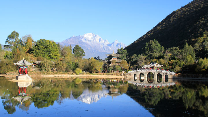 Jade Dragon Snow Mountain, reflected in the waters of Lijiang's Black Dragon Pool