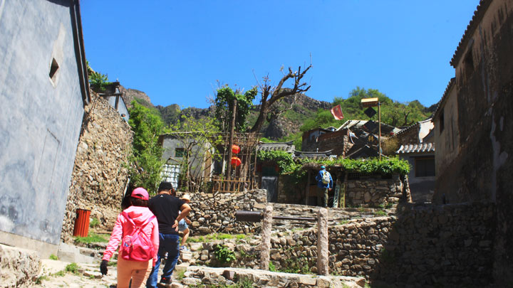 Hiking up ancient stone footpaths in the village