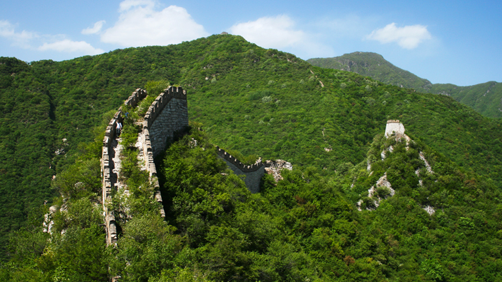 Rough 'wild' Great Wall runs through the mountains on the Nine-Eyes Tower hike