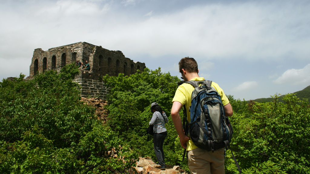 Nine Eyes Tower Great Wall | Hikers approach Nine-Eyes Tower, the highest point of the hike