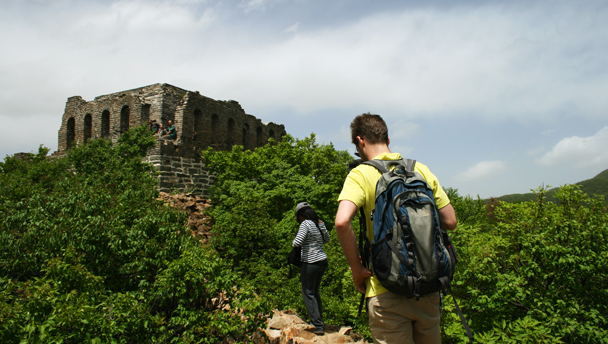 Hikers approach the Nine Eyes Tower, the highest point of the hike