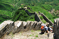 Hikers on the wild Great Wall in Huairou District