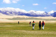 Hiking in grassy meadows near Qinghai Lake