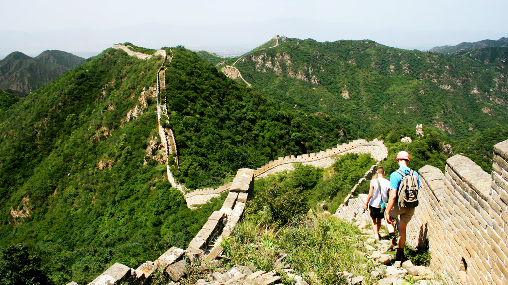 Switchback Great Wall | Hikers following the unrestored Great Wall in Yanqing District.