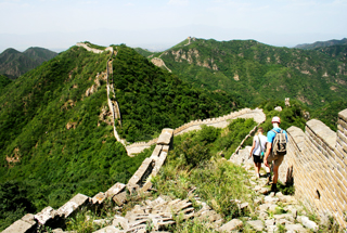 Hikers following the unrestored Great Wall in Yanqing District.