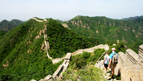 Hikers following the unrestored Great Wall in Yanqing District