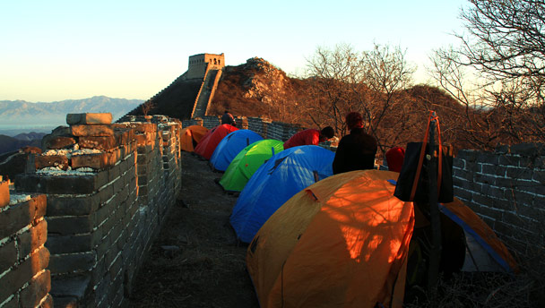 Our campsite on unrestored wild wall below a Great Wall tower