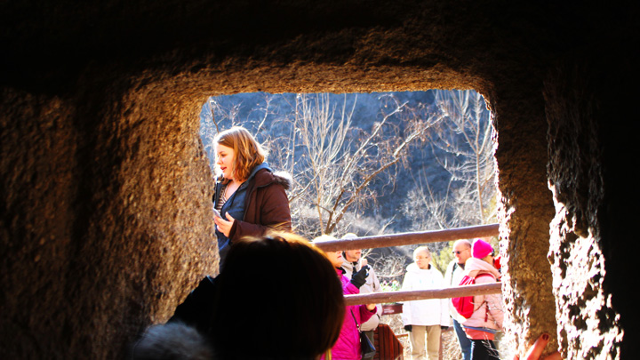 Looking out a window in a cave dwelling
