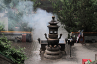 Incense smoke wafts from an incense burner at Tanzhe Temple
