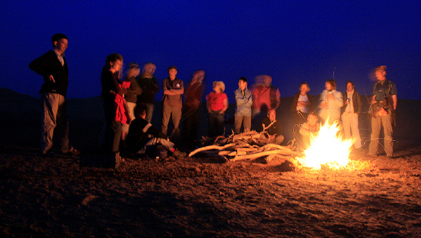 Hikers and a campfire in the Tengger Desert