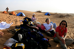 Hikers relax at a campsite in the desert