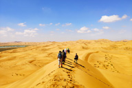 Hiking through the huge dunes of the Tengger Desert in Inner Mongolia