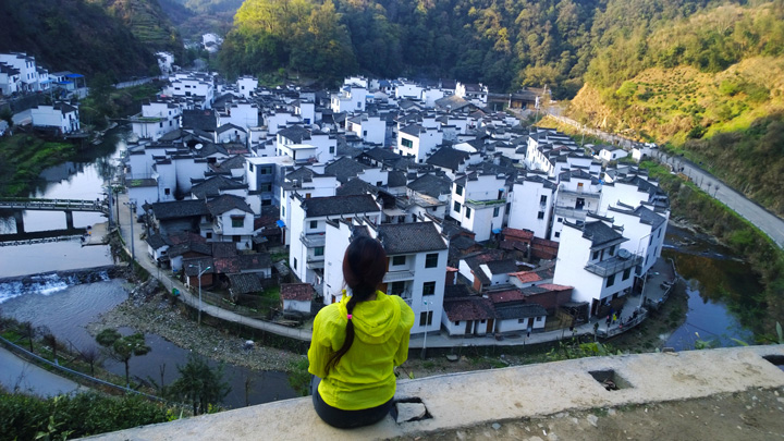 A river wraps around a village in Wuyuan