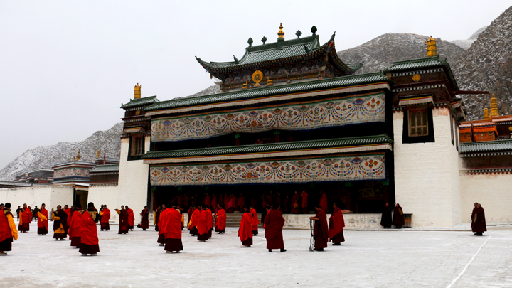 Monks gather outside the hall of a monastery