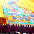 Monks unveiling a huge cloth thangka