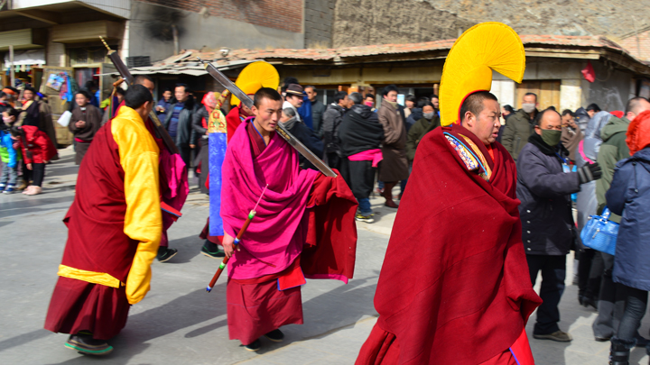 Part of a procession through the streets of Xiahe