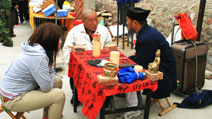 A Taoist fortune-teller at the fair