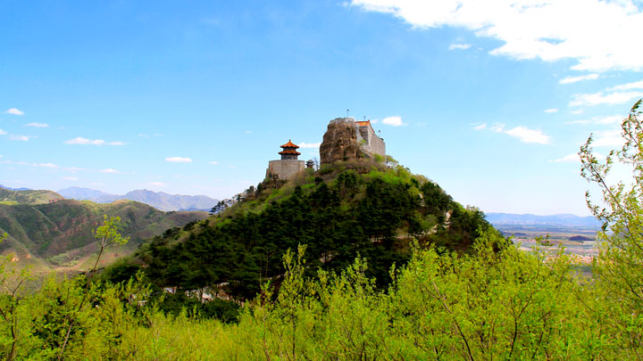 The temples atop the mountain, seen from the back trail