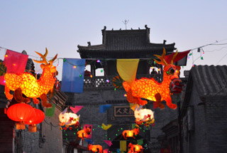 Lanterns line a lane at night in Nuanquanzhen