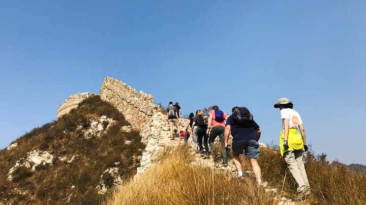 Hiking over a crest on the Great Wall at Zhenbiancheng