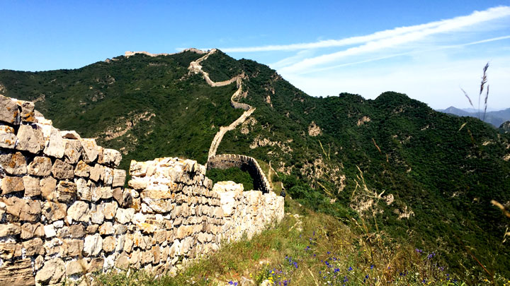 The Great Wall snakes up to a high peak
